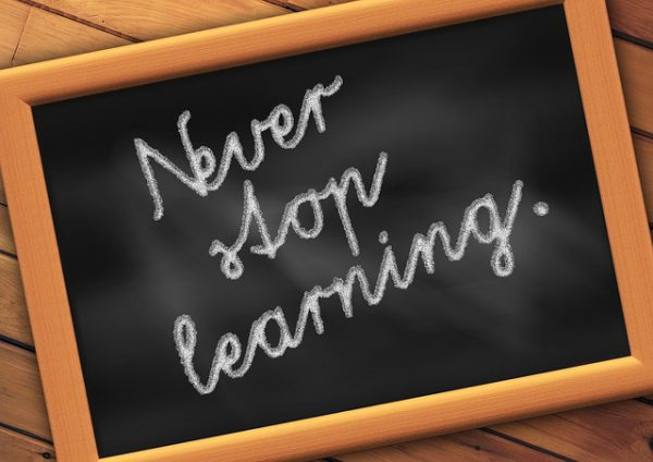 board saying: never stop learning