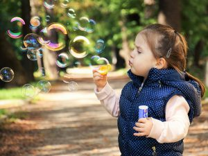 Child produces soap bubbles