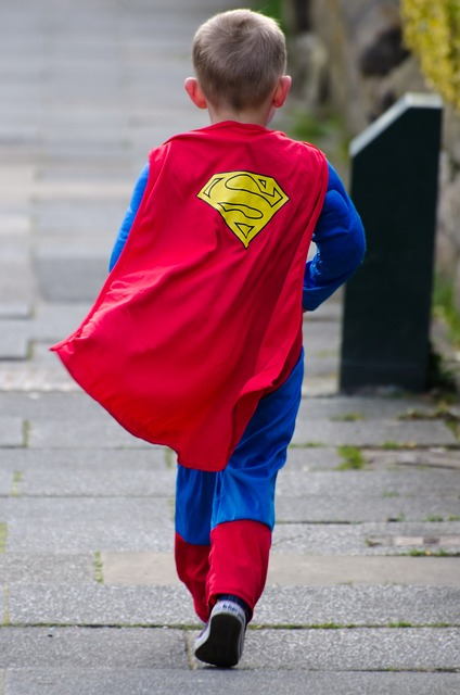 Children dressed up as superman
